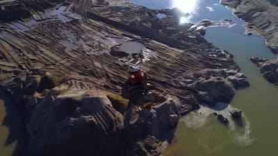 Excavator in the Sand Quarry
