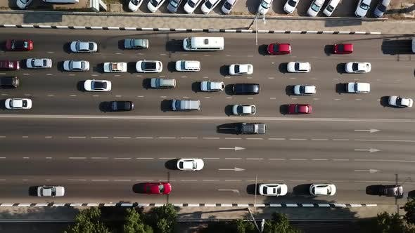 Thumbnail for Aerial Drone Flight Top Down View of Freeway Busy City Rush Hour Heavy Traffic Jam Highway.