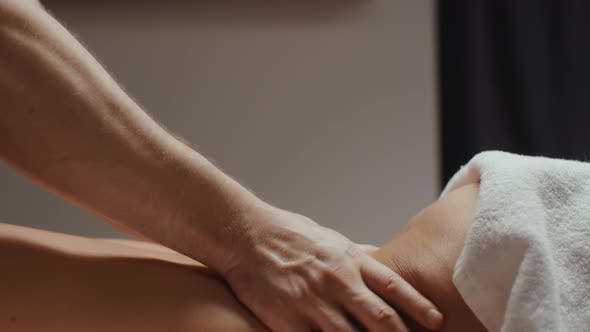 Thumbnail for Woman Receiving Lower Back Massage Rejuvenating Procedure in Spa Center Male Chiropractor