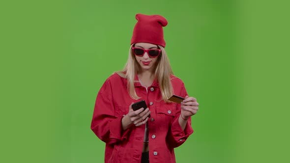 Thumbnail for Teenager Is Holding a Credit Card and Phone. Green Screen