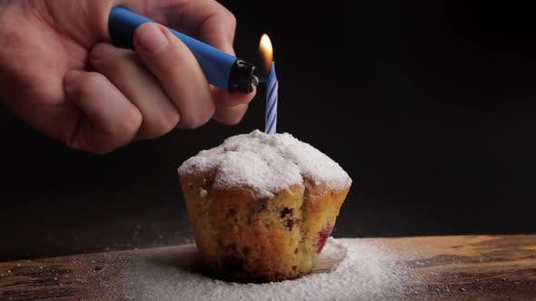 Thumbnail for Lighting a Candle on a Muffin