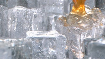 Whisky Pouring on Ice