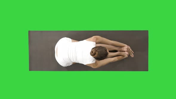 Thumbnail for Young Blond Attractive Woman Practicing Yoga, Doing Seated Forward Bend Exercise, Paschimottanasana