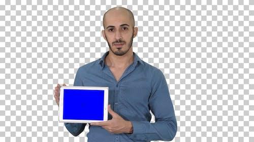 Arab man showing blank tablet screen, Alpha Channel