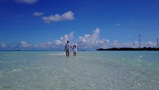 Romantic people in love dating on vacation spend quality time on beach on white sand background