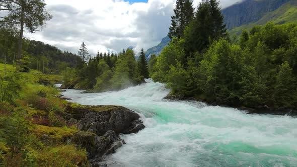 Milky Blue Glacial Water From the Kjenndalsbreen Glacier