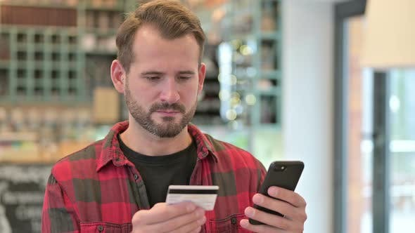 Thumbnail for Portrait of Online Payment Failure on Smartphone By Young Man