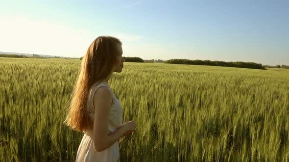 Thumbnail for Girl Walking in Wheat Field at Sunset Slow Motion