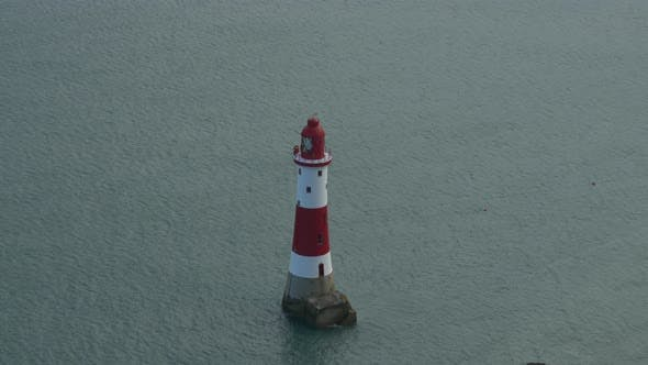 Thumbnail for Red and white lighthouse in the sea