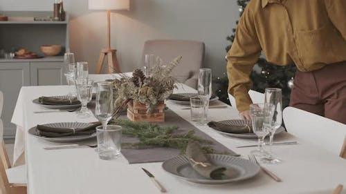 Decorator Adding Finishing Touches to Festive Table