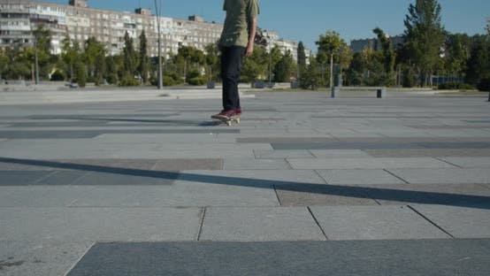 Thumbnail for Skater Grunge, a Skater Boy Is Stopping with a Turn, Close Up,