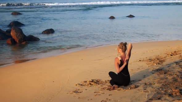 Thumbnail for Tremendous Lady in Black Tracksuit Sits in Yoga Pose