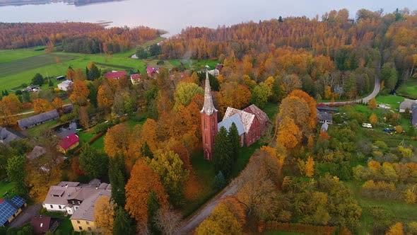 Aerial view of an old church in the middle of a village, Estonia.