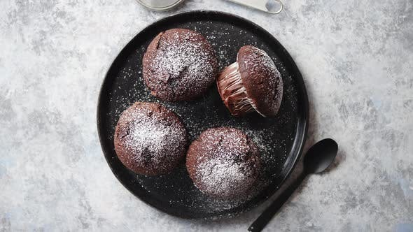Thumbnail for Fresh and Tasty Chocolate Muffins Served on Plate