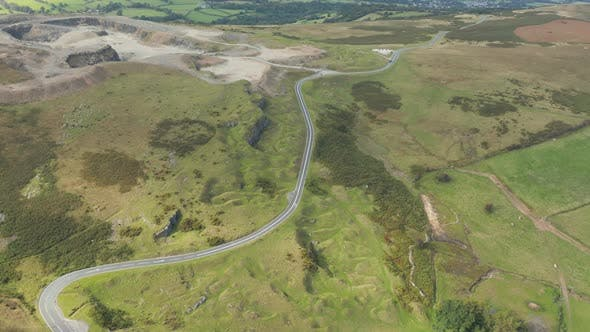 Thumbnail for Aerial drone view of a winding mountain road