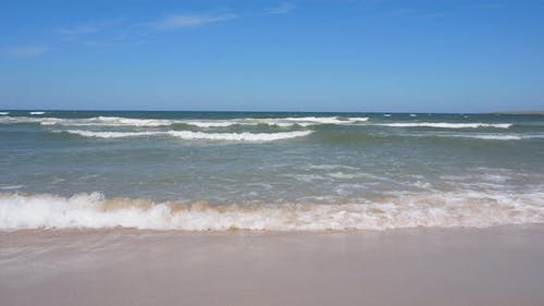 Beautiful Waves on the Shore of a Sandy Beach