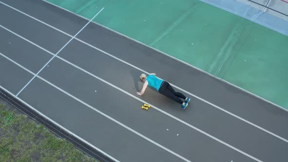 Thumbnail for Aerial Shot of Overweight Woman Doing Push Ups
