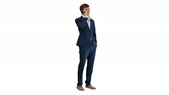 Thumbnail for Handsome Young Businessman Talking on the Phone on White Background