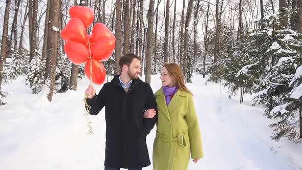 Guy and a Girl on a Date Cute Chat Walking in the Woods on a Winter Day, Love Story