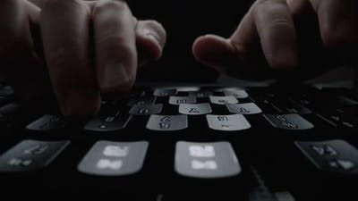 Closeup Typing on Keyboard with Man Fingers