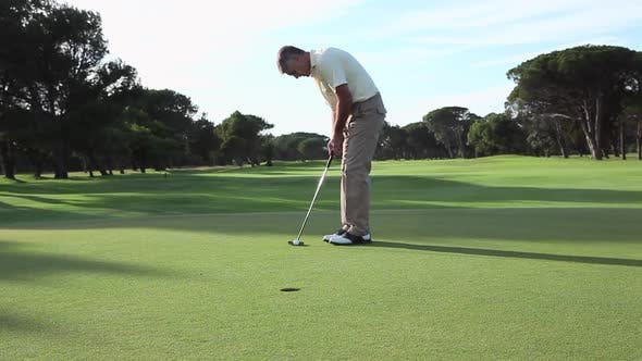 Thumbnail for Mature man playing golf on golf course