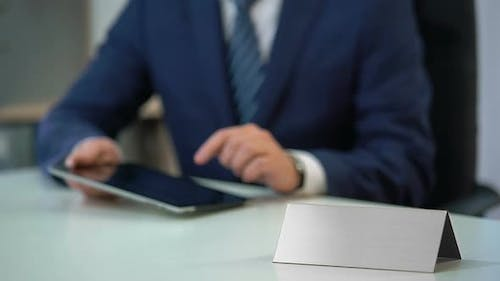 Man in Business Suit Working on Tablet Pc, Blank Nameplate Template for Text