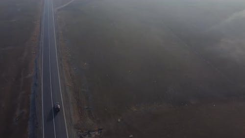 Car On The Highway In The Foggy Morning