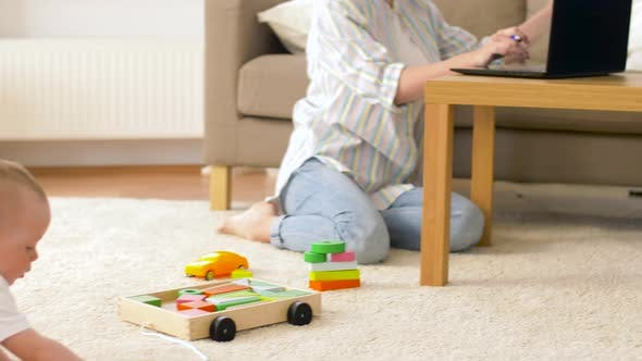 Thumbnail for Working Mother and Baby Boy Playing at Home Office 15