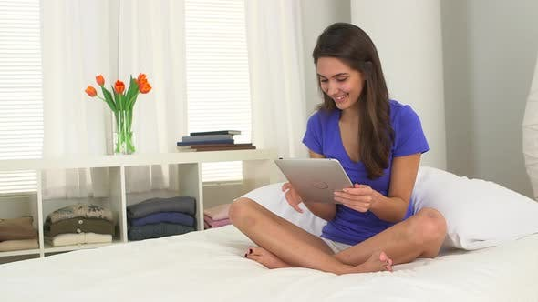 Thumbnail for Young Caucasian woman using a tablet