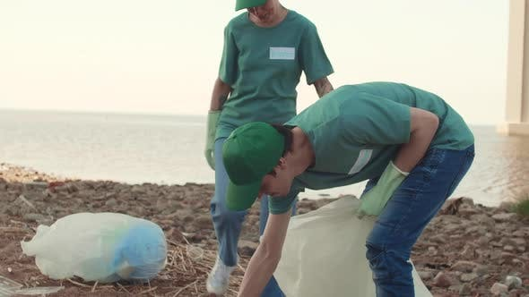 Thumbnail for Group of Eco Activists Picking up Litter on Coast