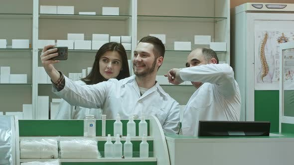 Thumbnail for Cheerful Team of Pharmacist and Interns Take Selfie Via Smartphone at Workplace