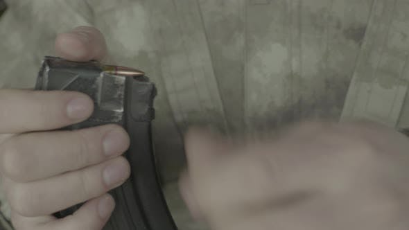 Thumbnail for Cartridges Charge. Close-up. Shooting