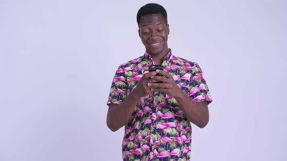 Thumbnail for Young Happy African Tourist Man Using Phone