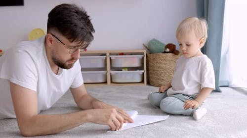 Father and Son Playing at Home and Spending Time Together, Real Time, Copy Space, Father's Day