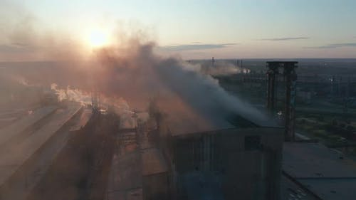 Aerial View. High Chimney Pipe with Grey Smoke. Concept of Environmental Pollution, Climate Change