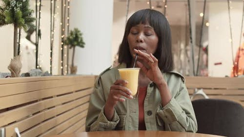 African Woman Drinking Milkshake