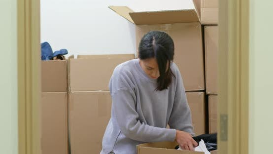 Thumbnail for Woman find the product inside cardboard box