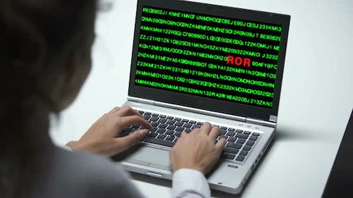 System Error on Laptop Computer, Woman Working in Office, Cybercrime, Hacking