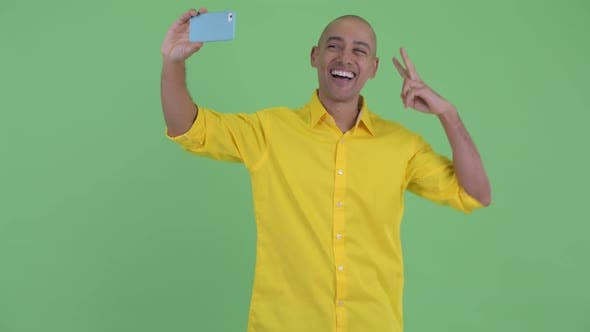 Thumbnail for Happy Handsome Bald Businessman Taking Selfie with Phone