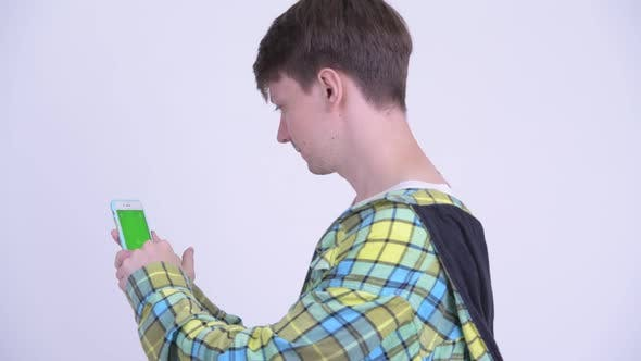 Thumbnail for Rear View of Young Handsome Man Using Phone