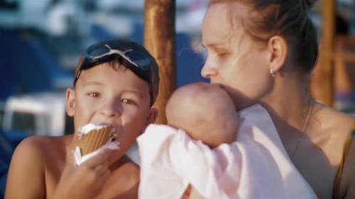 Mother with Baby and Elder Son at the Beach