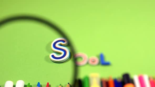Thumbnail for School Word And Education Tools Behind Magnifying Glass