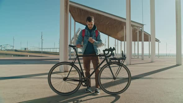 Trendy Young Commuter Man with Bicycle and Phone