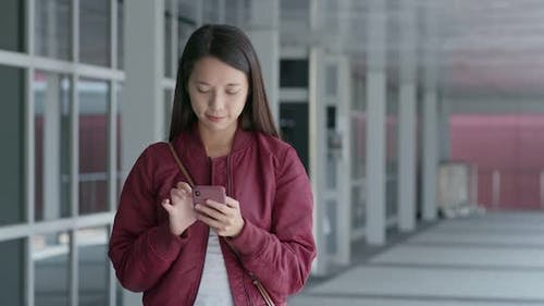 Young woman look at mobile phone