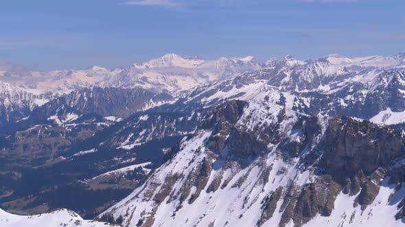 Cover Image for Panoramic View From the High Mountain To Snowy Peaks in Switzerland Alps. Rochers-de-Naye