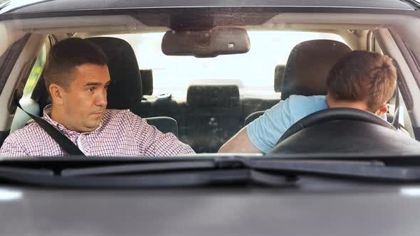 Thumbnail for Car Driving School Instructor Teaching Man Driver