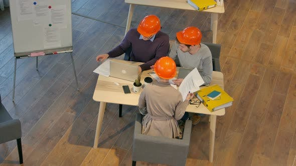 Group of Architects Planning a Project
