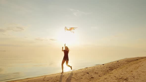Thumbnail for Happy Young Woman Running with a Kite.