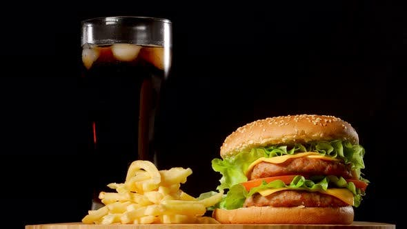 Thumbnail for Burger with French Fries and a Glass with Ice Cola on a Black Rustic Background