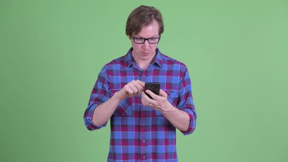 Cover Image for Happy Young Handsome Hipster Man Using Phone and Getting Good News